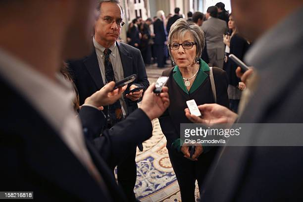 Sen Barbara Boxer talks to reporters after the Senate Democrats' weekly policy luncheon at the US Capitol December 11 2012 in Washington DC Senate...