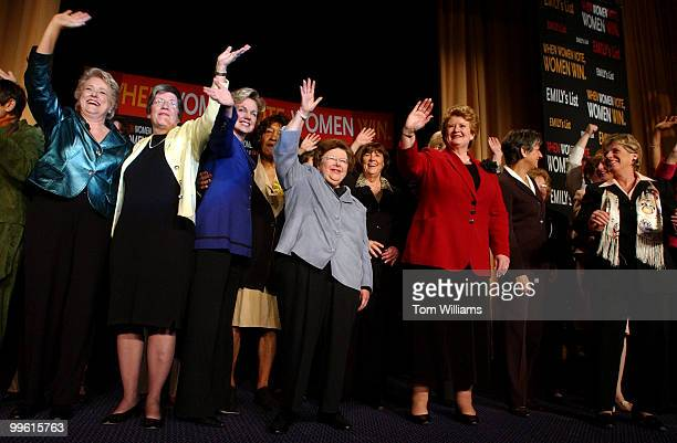 Sen Barbara Mikulski DMd center Sen Debbie Stabenow DMich right in red and Ellen Malcolm far left in green president of Emily's List attend the 20th...