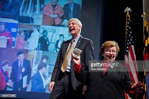 Sen Barbara Mikulski DMd shows off a pair of earrings given to her by Dr Francis S Collins left Director of the National Institutes of Health after...