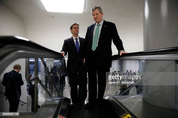Sen Ben Sasse at left and Sen John Kennedy make their way to the US Capitol January 18 2018 in Washington DC Congress is working to avoid a...