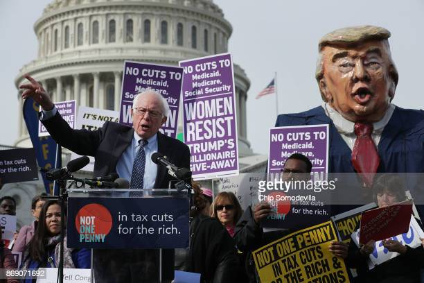 Sen Bernie Sanders addresses a rally against the Republican tax plan outside the US Capitol November 1 2017 in Washington DC The rally was organized...