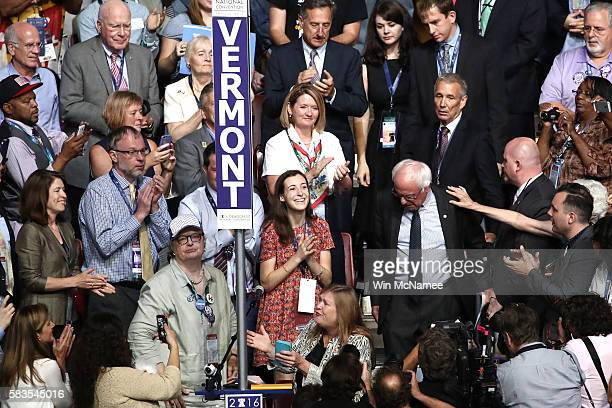 Sen Bernie Sanders along with his wife Jane O'Meara Sanders arrive on the floor during roll call on the second day of the Democratic National...