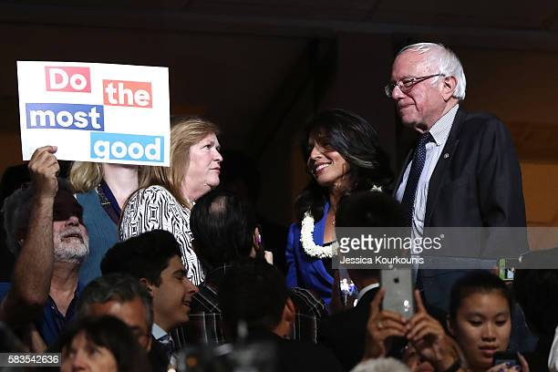 Sen Bernie Sanders along with his wife Jane O'Meara Sanders stand with US representative Tulsi Gabbard during the second day of the Democratic...