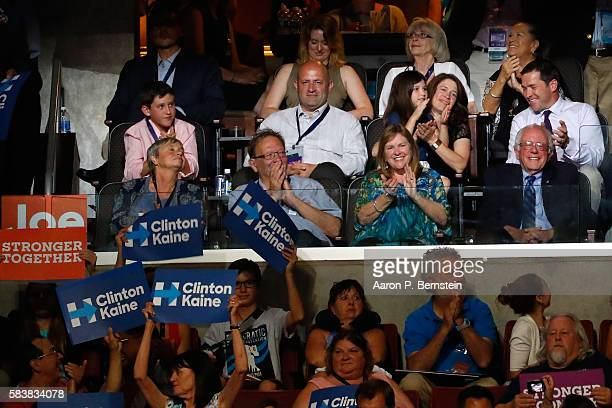 Sen Bernie Sanders along with his wife Jane O'Meara Sanders acknowledge the crowd during US Vice President Nominee Tim Kaine 's speech on the third...
