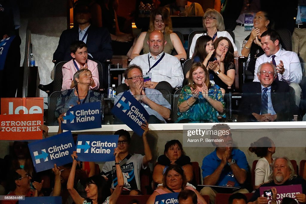 Sen. Bernie Sanders (R) along with his wife Jane O'Meara Sanders (2nd-R) acknowledge the crowd during US Vice President Nominee Tim Kaine 's speech on the third day of the Democratic National Convention at the Wells Fargo Center, July 27, 2016 in Philadelphia, Pennsylvania. Democratic presidential candidate Hillary Clinton received the number of votes needed to secure the party's nomination. An estimated 50,000 people are expected in Philadelphia, including hundreds of protesters and members of the media. The four-day Democratic National Convention kicked off July 25.