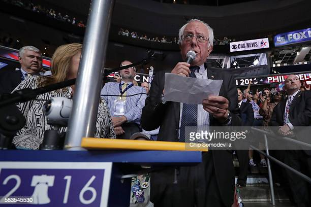 Sen Bernie Sanders along with the Vermont delegation and his wife Jane O'Meara Sanders cast their votes during roll call on the second day of the...