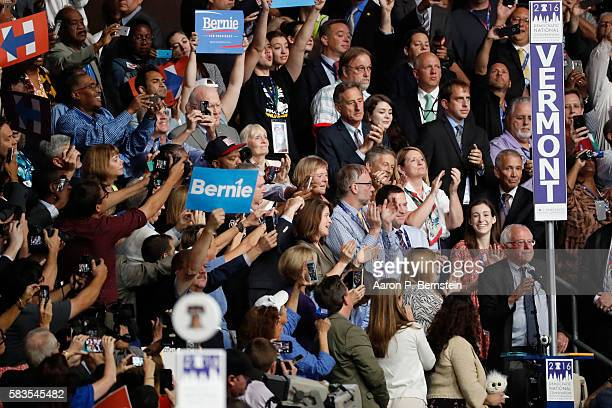Sen Bernie Sanders along with the Vermont delegation cast their votes during roll call on the second day of the Democratic National Convention at the...