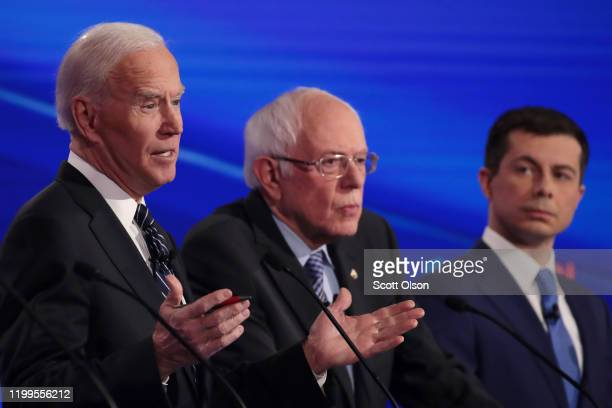 Sen Bernie Sanders and former South Bend Indiana Mayor Pete Buttigieg listen as former Vice President Joe Biden speaks during the Democratic...