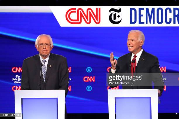 Sen Bernie Sanders and former Vice President Joe Biden react on stage during the Democratic Presidential Debate at Otterbein University on October 15...
