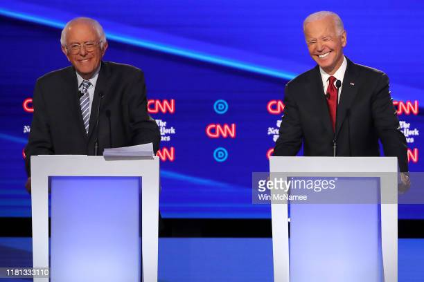 Sen Bernie Sanders and former Vice President Joe Biden smile on stage during the Democratic Presidential Debate at Otterbein University on October 15...