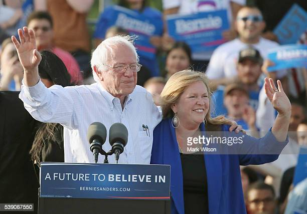 Sen Bernie Sanders and his wife Jane O'Meara Sanders appear at a campaign rally at Robert F Kennedy Memorial Stadium June 9 2016 in Washington DC...