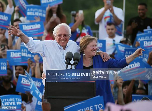 Sen Bernie Sanders and his wife Jane O'Meara Sanders wave after speaking at a campaign rally at Robert F Kennedy Memorial Stadium June 9 2016 in...