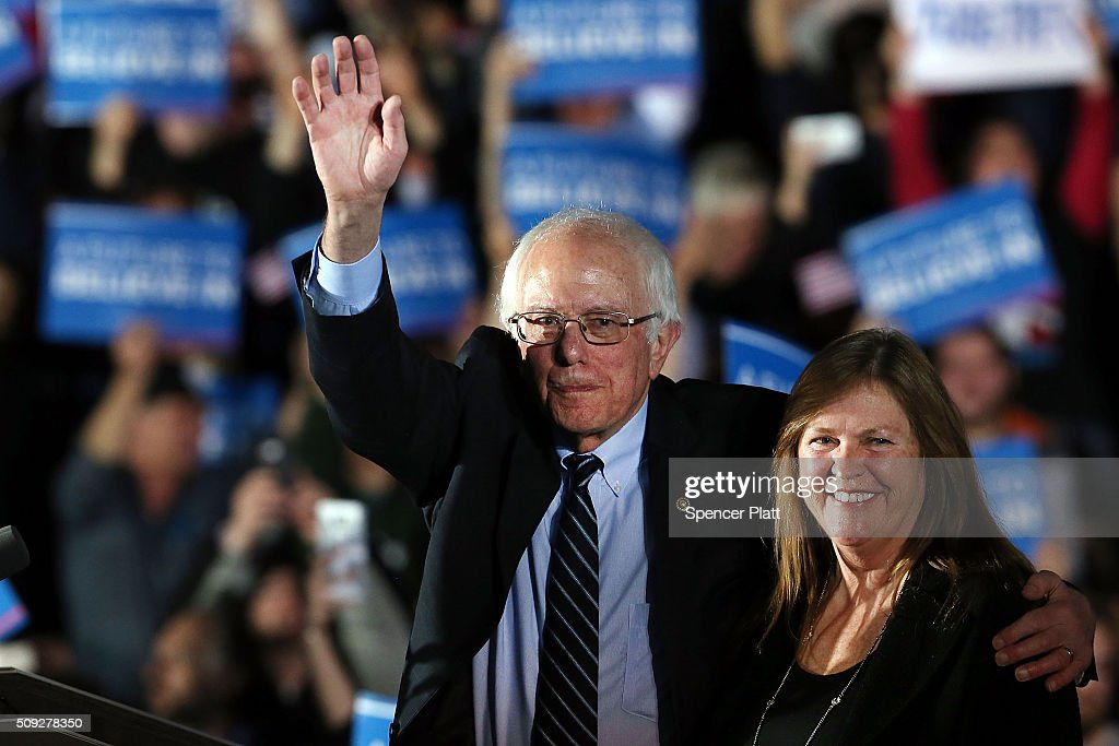 Sen. Bernie Sanders (D-VT) and his wife Jane O'Meara Sanders wave to supporters onstage after declaring victory over Hillary Clinton in the New Hampshire Primary onFebruary 9, 2016 in Concord, New Hampshire. Sanders was projected the winner shortly after the polls closed.