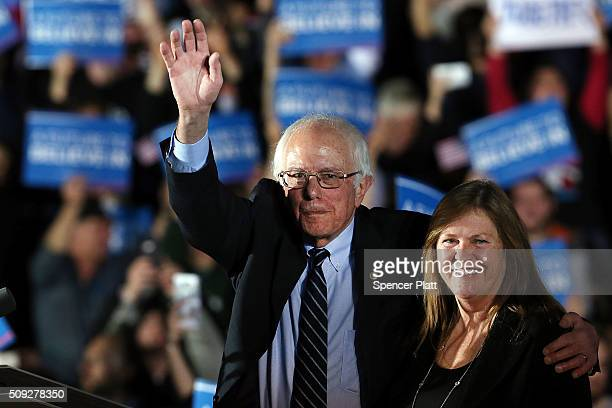 Sen Bernie Sanders and his wife Jane O'Meara Sanders wave to supporters onstage after declaring victory over Hillary Clinton in the New Hampshire...