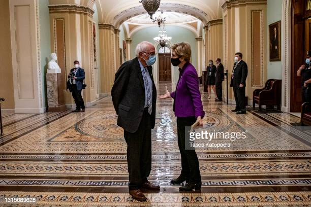 Sen. Bernie Sanders and Sen. Elizabeth Warren chat after U.S. President Joe Biden spoke at a joint session of Congress in the House chamber of the...