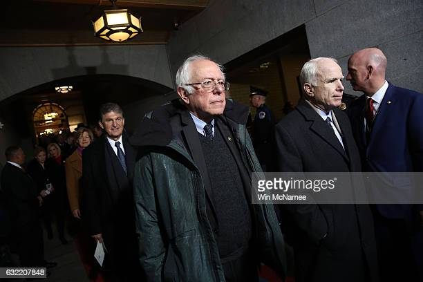 Sen Bernie Sanders and Sen John McCain arrive arrive on the West Front of the US Capitol on January 20 2017 in Washington DC In today's inauguration...