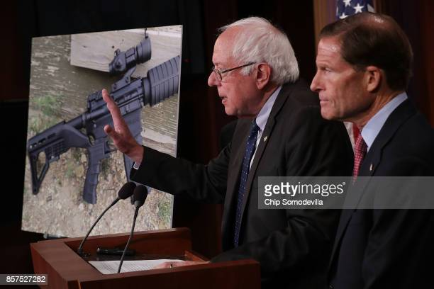 Sen Bernie Sanders and Sen Richard Blumenthal hold a news conference to announce proposed gun control legislation at the US Capitol October 4 2017 in...