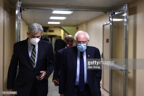 Sen. Bernie Sanders and Sen. Sheldon Whitehouse leave after a procedural vote on the nomination of Polly Ellen Trottenberg to be Deputy Secretary of...