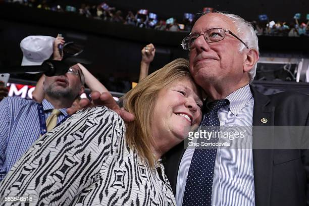 Sen Bernie Sanders embraces his wife Jane O'Meara Sanders after the Vermont delegation cast their votes during roll call on the second day of the...