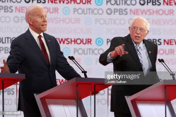 Sen Bernie Sanders gestures as former Vice President Joe Biden listens during the Democratic presidential primary debate at Loyola Marymount...