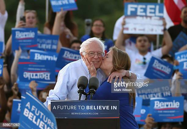 Sen Bernie Sanders gets a kiss from his wife Jane O'Meara Sanders after speaking at a campaign rally at Robert F Kennedy Memorial Stadium June 9 2016...