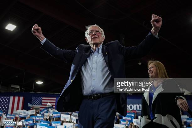 Sen Bernie Sanders IVt US 2020 Democratic Presidential Candidate and his wife Jane Sanders go up to the stage during Super Tuesday rally at Champlain...