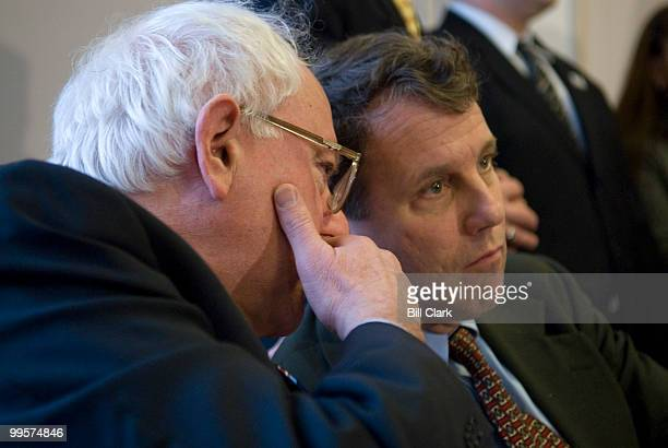 Sen. Bernie Sanders, I-Vt., whispers to Sen. Sherrod Brown, D-Ohio during a news conference with Veterans of the war in Iraq, to discuss the effects...