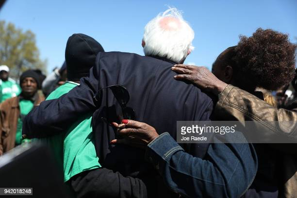 Sen Bernie Sanders joins with others during an event to mark the 50th anniversary of Dr Martin Luther King Jr's assassination April 4 2018 in Memphis...