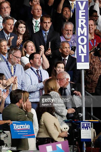 Sen Bernie Sanders kisses his wife Jane O'Meara Sanders after the Vermont delegation cast their votes during roll call on the second day of the...