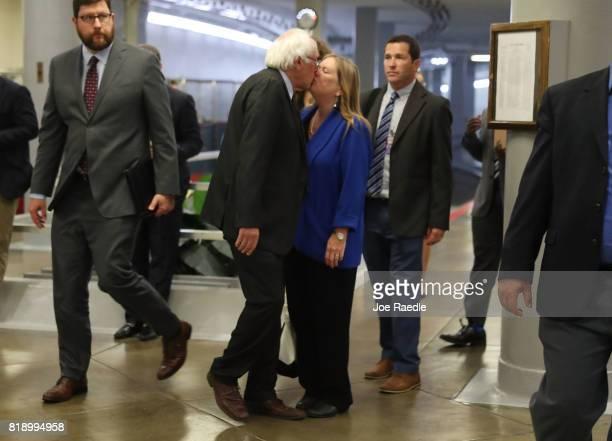 Sen Bernie Sanders kisses his wife Jane Sanders as he arrives for an allsenators closed briefing on ISIL in the US Capitol on July 19 2017 in...