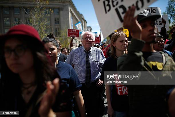 """Sen. Bernie Sanders participates in a """"Don't Trade Our Future"""" march organized by the group Campaign for America's Future April 20, 2015 in..."""