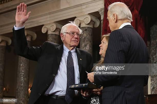 S Sen Bernie Sanders participates in a reenacted swearingin with his wife Jane OÕMeara Sanders and US Vice President Joe Biden in the Old Senate...