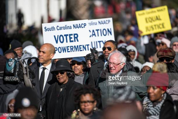 S Sen Bernie Sanders right president of the South Carolina NAACP chapter Brenda Murphy center and Sen Cory Booker march down Main St to the...