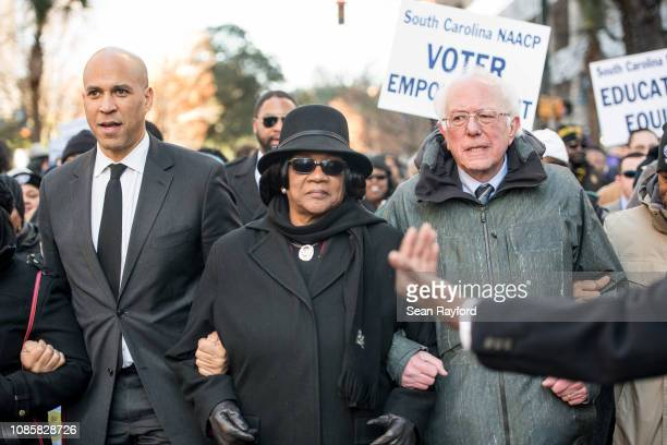 S Sen Bernie Sanders right president of the South Carolina NAACP chapter Brenda Murphy center and Sen Cory Booker march to the Statehouse in...