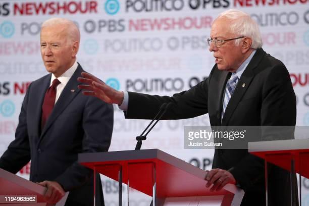Sen Bernie Sanders speaks as former Vice President Joe Biden listens during the Democratic presidential primary debate at Loyola Marymount University...