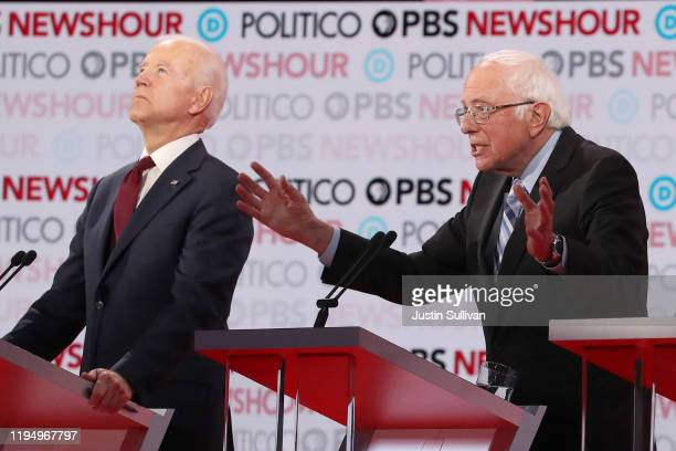 Sen Bernie Sanders speaks as former Vice President Joe Biden listens during the Democratic presidential primary debate at Loyola Marymount University...