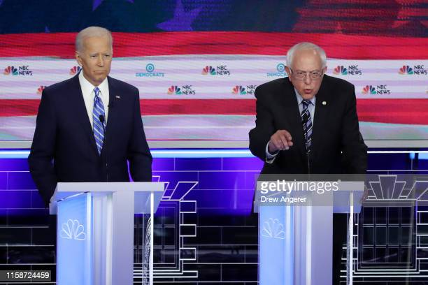 Sen Bernie Sanders speaks as former Vice President Joe Biden looks on during the second night of the first Democratic presidential debate on June 27...