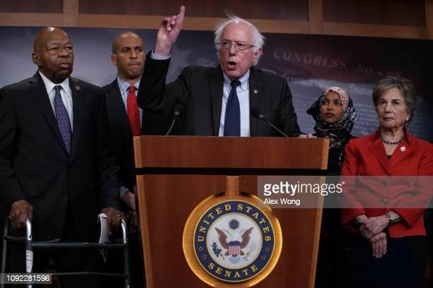 S Sen Bernie Sanders speaks as Rep Elijah Cummings Sen Cory Booker Rep Ilhan Omar and Rep Jan Schakowsky listen during a news conference on...