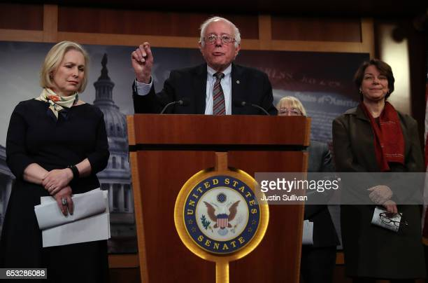 S Sen Bernie Sanders speaks as Sen Kirsten Gillibrand and Sen Amy Klobuchar look on during a news conference at the US Capitol on March 14 2017 in...