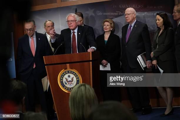 Sen. Bernie Sanders speaks as Senate Minority Leader Sen. Chuck Schumer , Sen. Tom Carper , Sen. Debbie Stabenow , Sen. Pat Leahy , Sen. Maria...