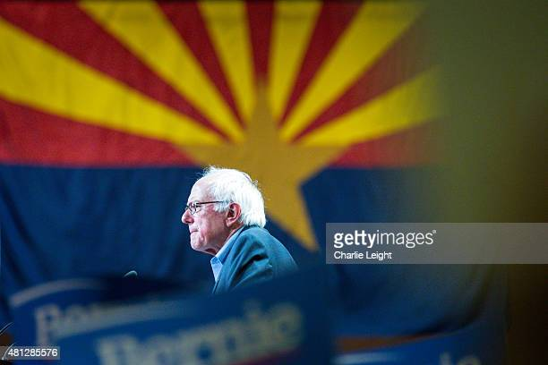 S Sen Bernie Sanders speaks in front of the Arizona state flag to the Phoenix Rally crowd at the Phoenix Convention Center July 18 2015 in Phoenix...