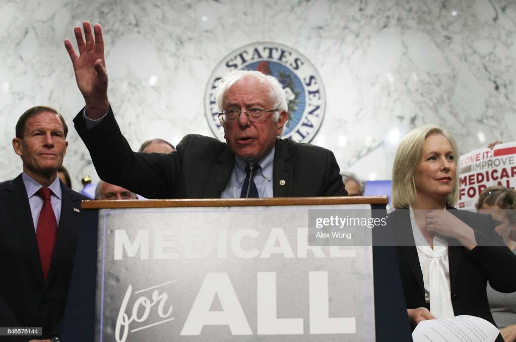 U.S. Sen. Bernie Sanders (I-VT) (C) speaks on health care as Sen. Richard Blumenthal (D-CT) (L) and Sen. Kirsten Gillibrand (D-NY) (R) listen during an event September 13, 2017 on Capitol Hill in Washington, DC. Sen. Sanders held an event to introduce the Medicare for All Act of 2017.