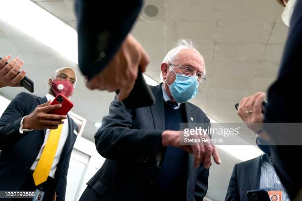 Sen. Bernie Sanders speaks to reporters in the Senate Subway during a roll call vote on April 13, 2021 in Washington, DC. Senate Republicans...