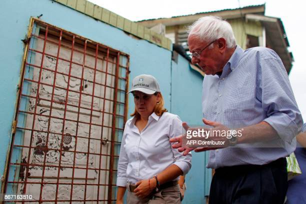 US Sen Bernie Sanders talks to the Mayor of San Juan Carmen Yulin Cruz during a visit to the Playita community in San Juan Puerto Rico on October 27...