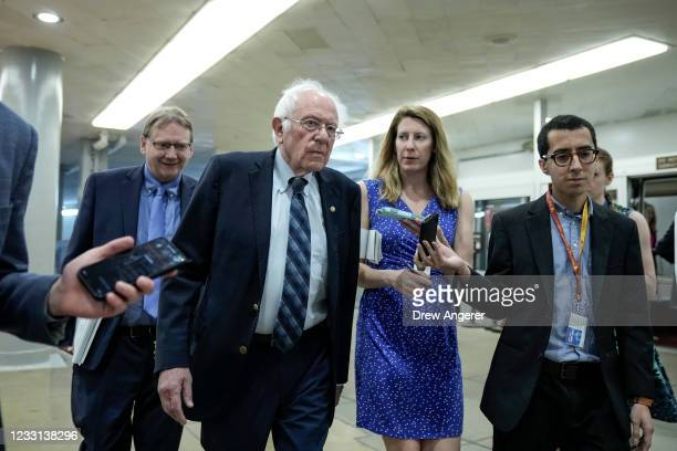 Sen. Bernie Sanders talks with reporters as he walks through the Senate subway on his way to a vote at the U.S. Capitol May 27, 2021 in Washington,...