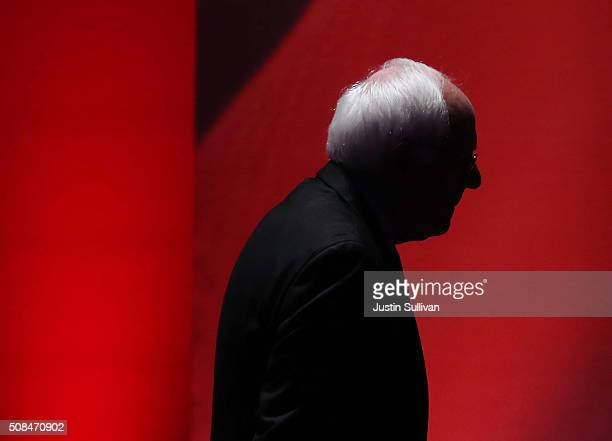 S Sen Bernie Sanders walks off stage during a break as he debates with Democratic presidential candidates former Secretary of State Hillary Clinton...