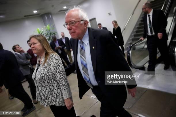 Sen Bernie Sanders walks with his wife Jane after leaving the Senate floor for a vote on legislation advancing Senate Majority Leader Mitch...