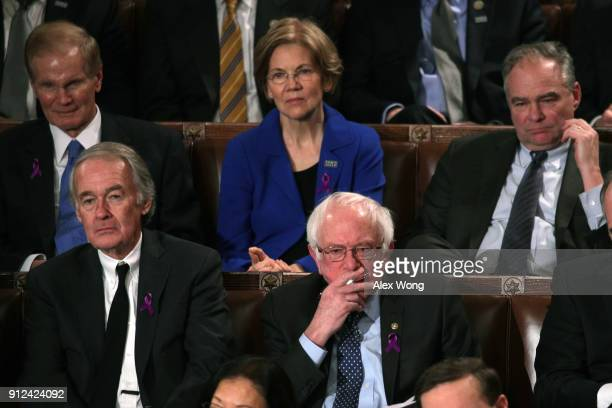 S Sen Bernie Sanders watches during the State of the Union address in the chamber of the US House of Representatives January 30 2018 in Washington DC...
