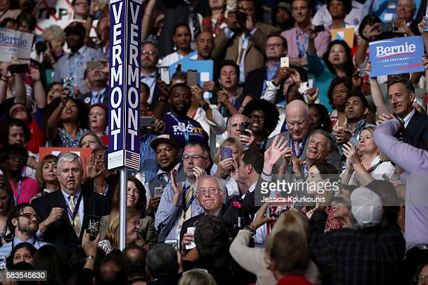 Sen Bernie Sanders waves to the crowd after the Vermont delegation cast their votes during roll call on the second day of the Democratic National...