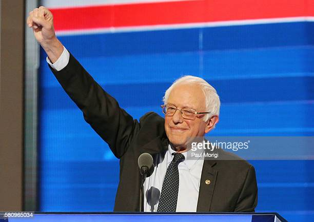 Sen Bernie Sanders waves to the crowd before delivering his remarks on the first day of the Democratic National Convention at the Wells Fargo Center...